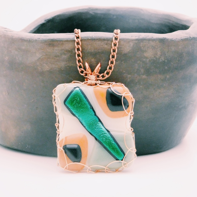 Fused glass pendant with wire wrapping green dichroic