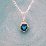 fused glass pendant with blue dichroic