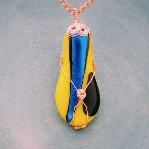 copper wrapped yellow and blue dichroic glass fusion pendant