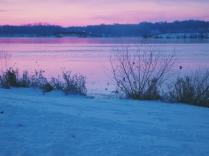 sunrise over lake with bridge