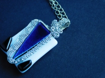 One of my favorite jewelry pieces so far: fused glass, white with blue dichroic and black, wrapped in silver-coated wire