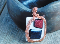 Another new piece: fused glass, white with red and black dichroic, wrapped in copper